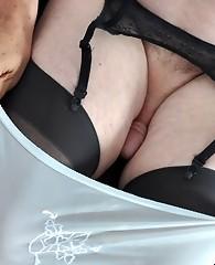 A pantie boy stud puts on his suspenders and panties slowly