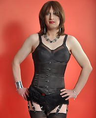 A very sultry TGirl showing off her red and black dress.