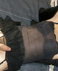 Smiling crossdresser shows off her thick cock and gorgeous black lingerie.