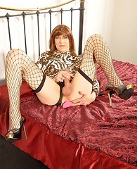 This crossdresser loves to play with her hard cock with a toy shoved deep inside her ass!