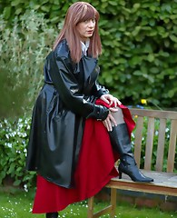 Juicy Luci May wore her lovely long rubber trench coat and a long red skirt, before becoming an all over Domme. How would you like to be kneeling on t