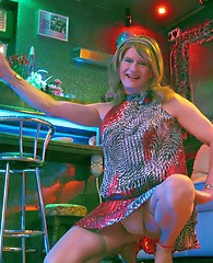 Leggy TGirl with a very short skirt on shows off her pins in the club.