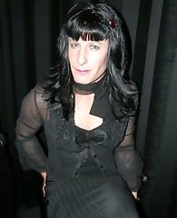 Dark haired leggy crossdresser in a sleek black top and tight skirt