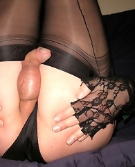 Nylon Bitch Yvette wearing sexy black nylons and rubbing her cock