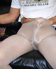 Horny pantie lover looking through a nylon pantie fetish mag, cuts a hole in his pantyhose to wank off his big hard cock