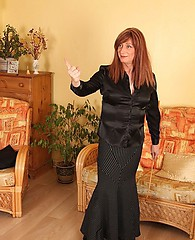 After giving this mature tranny student a hard ass spanking, Mistress Luci May makes her pull her panties down, get on her knees and suck her cock