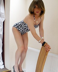 Hot horny TGirl Kirsty showing off her tight fit body and big cock in sexy swim suit