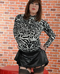 Sexy TGirl Emily flashes her silky nylon stockings and leopard top before wanking her big hard cock