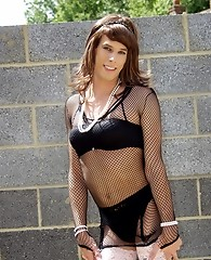 Sexy crossdresser wearing fishnet dress and black nylons