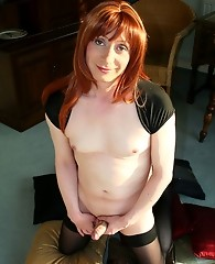 Lucimay plays with her big cock on a bed of cushions