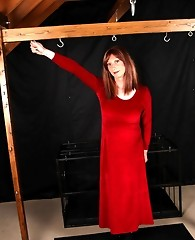 Sexy Lucimay is wearing a long velvet dress and is all tied up