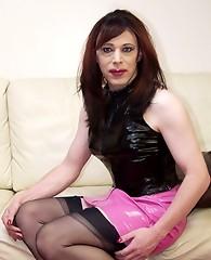 Pink PVC mini skirt covers this crossdressers sweet ass
